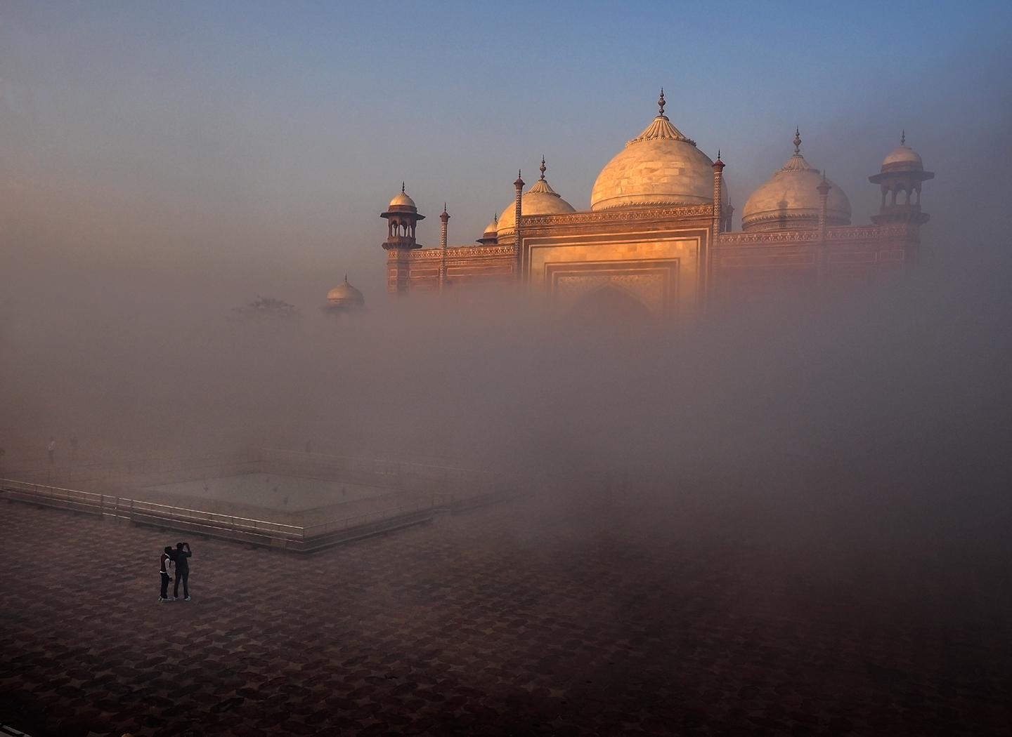 Photo of the Taj Mahal shrouded in clouds